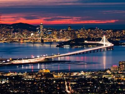 San Francisco bridge and skyline at sunset