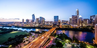 The skyline of Austin Texas at sunset- Remote Report
