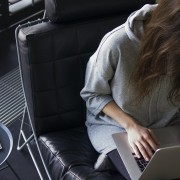 Woman working on her laptop at home