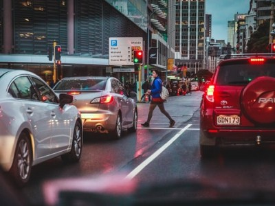 Pedestrian crossing the street in busy city
