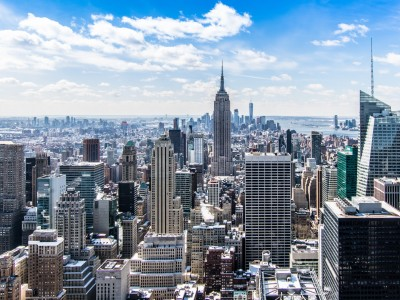 Empire State Building and New York City skyline on sunny day