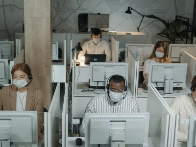 Office workers in cubicles on computers