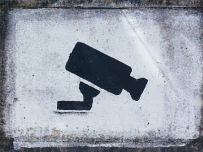 A security camera painted on a wall