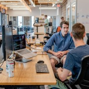Three sitting workers talk at office- Remote Report