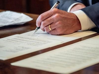 Calif. Gov. Gavin Newsom's hand signs an order