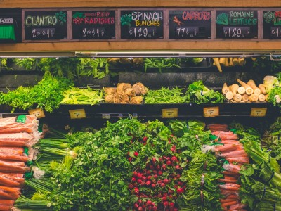 Vegetables on display at grocery store produce section