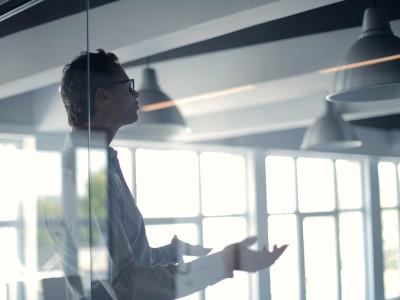 Office worker in glass office
