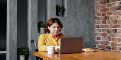 Person in wheelchair working on laptop