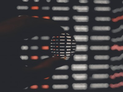 close up of computer screen with hand pinching a circle lens