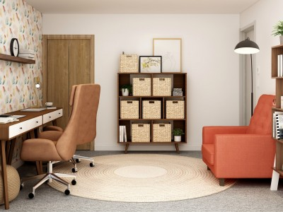 Home office with desk, book case and orange chair