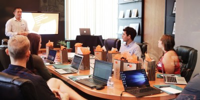 People working on laptops at conference room