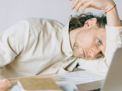 Man with head down on desk