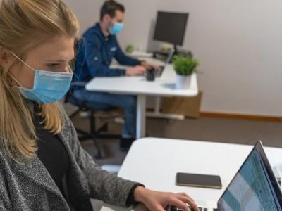 Employees wearing masks at work