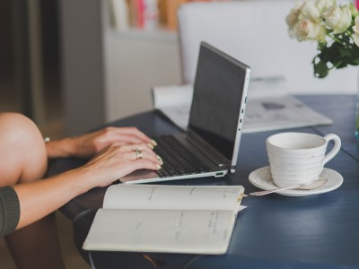 Person on laptop at kitchen table