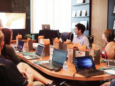 Manager leads meeting around conference table